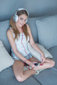Cute pretty woman listening to her music - PhotoDune Item for Sale