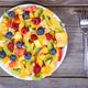 Top view of a fresh fruit salad with bananas kiwi orange blueber - PhotoDune Item for Sale