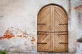 Wooden door in an old style. Courtyard of old castle - PhotoDune Item for Sale