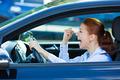 Angry, Screaming female Car Driver