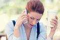 Sad, unhappy Woman Talking on Phone