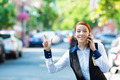 Business Woman on smart Phone Hails Taxi Cab