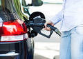 Woman at Gas Station, filling up her Car - PhotoDune Item for Sale
