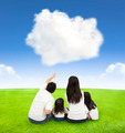 happy family on a meadow with sky and cloud background  - PhotoDune Item for Sale