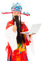 God of wealth holding a laptop and thumb up over white background - PhotoDune Item for Sale