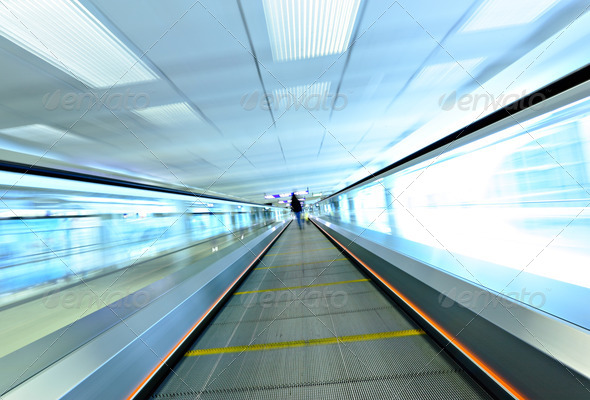 moving escalator with person - Stock Photo - Images