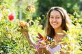 Female florist in summer garden - PhotoDune Item for Sale