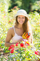 Woman gardening with roses - PhotoDune Item for Sale