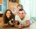 Family of four playing with kitten - PhotoDune Item for Sale