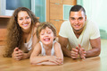Happy couple with child at home - PhotoDune Item for Sale