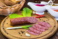 sausages on a wooden plate with vegetables in a restaurant - PhotoDune Item for Sale