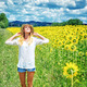 Joyful girl in sunflowers field - PhotoDune Item for Sale