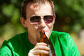 Man drinking beer from bottle - PhotoDune Item for Sale