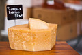 Chunk of cheese at outdoor market - PhotoDune Item for Sale