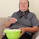 Grandmother Eating Popcorn on the Couch - VideoHive Item for Sale