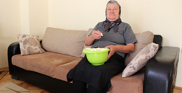 Grandmother Eating Popcorn on the Couch