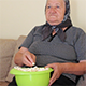 Grandmother Eating Popcorn from the Bowl - VideoHive Item for Sale