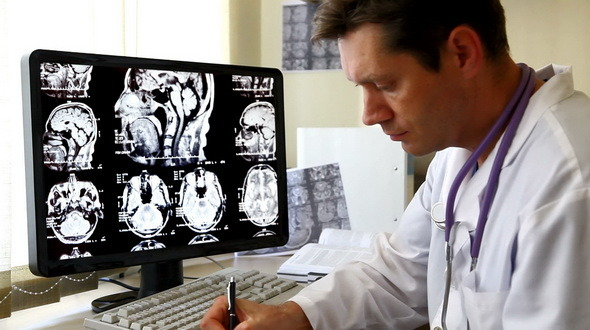 Doctor Looking At CT Scan