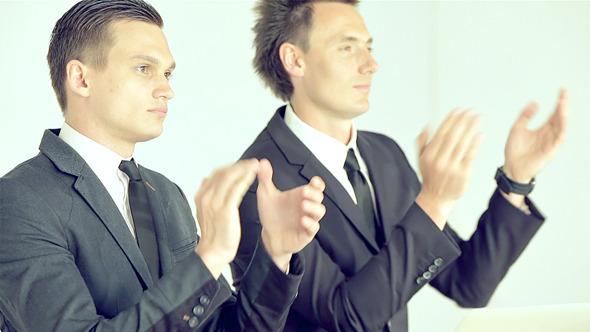 Businessmen Listening Attentively Speaker
