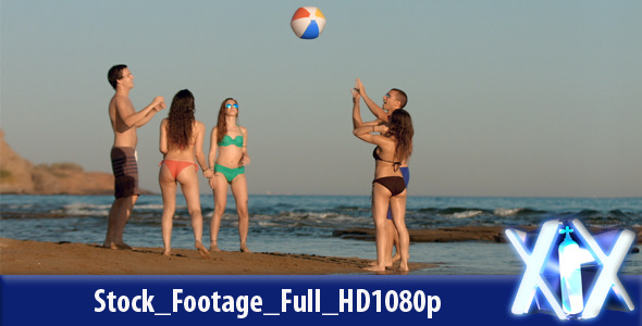 Young People Playing Ball On The Beach