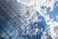 Skyscraper with reflection of blue sky and clouds - PhotoDune Item for Sale