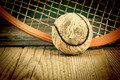 old tennis ball and racket on a wooden floor - PhotoDune Item for Sale