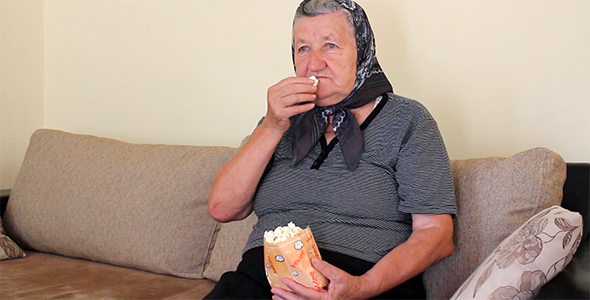 Grandmother Eating Popcorn