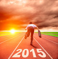 happy new year 2015. businessman running with sunrise background - PhotoDune Item for Sale