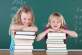Two playful young girls with their school books - PhotoDune Item for Sale
