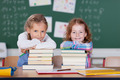 Two cute little girls with their school books - PhotoDune Item for Sale