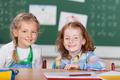 Two happy little girls in kindergarten - PhotoDune Item for Sale