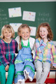 Laughing playful beautiful young girls in school - PhotoDune Item for Sale