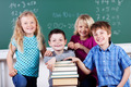 Young boys and girls in school with their books - PhotoDune Item for Sale