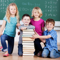 Schoolchildren with a tall stack of books - PhotoDune Item for Sale
