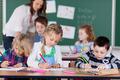 Young children studying in kindergarten school - PhotoDune Item for Sale