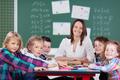 Female teacher leading a class activity - PhotoDune Item for Sale