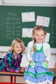 Two pretty young girls attending school - PhotoDune Item for Sale