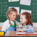 Two happy little girls in school - PhotoDune Item for Sale