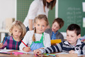 Smiling little girl in school with her friends - PhotoDune Item for Sale