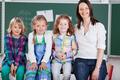 Happy school team of pupils and teacher - PhotoDune Item for Sale
