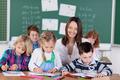 Attractive smiling female teacher in kindergarten - PhotoDune Item for Sale