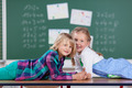 Two young girls in a school classroom - PhotoDune Item for Sale