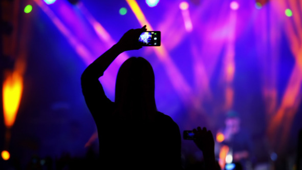 Girl with a Smartphone at a Rock Concert