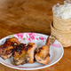 Sticky rice in bamboo container and Roasted chicken. - PhotoDune Item for Sale