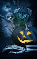 Black pumpkin with skeleton hand - PhotoDune Item for Sale