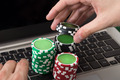 Businessman Using Laptop With Stacked Poker Chips - PhotoDune Item for Sale