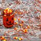 Scary Halloween pumpkin jar filled with candy - PhotoDune Item for Sale