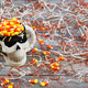 Closeup of scary Halloween skeleton skull cup filled with candy - PhotoDune Item for Sale