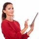 Charming hispanic woman using her tablet pc - PhotoDune Item for Sale