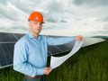 man holding solar panel station plans - PhotoDune Item for Sale